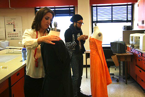 Emily Schroeder and Paul Ditty work on their sustainable fashion pieces.