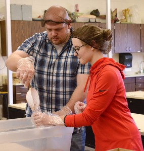 Casper College students Brian Hiser and Hannah Mica put cocoa mix into small bags to be given to Casper elementary students.