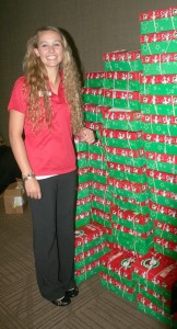 4-H'er Grace Anderson with some of shoesboxes filled for Operation Christmas Child.
