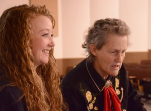 Student Tevyn Baldwin assists Temple Grandin just before the start of the presentation to students.