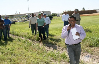 Islam leads group during a forage field day.